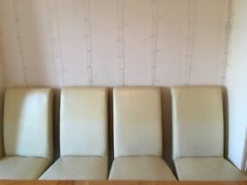 Reduced price 4 dining room chairs. Cream colour faux leather, need attention so great for a project