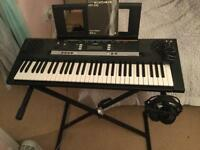 Yamaha keyboard with headphones