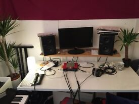 Cozy rehearsal room /music studio /practice space /writing room with pianos, drums & guitar from £15