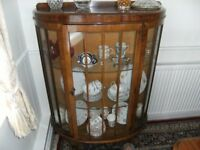 bow fronted display cabinet with 2 glass shelves