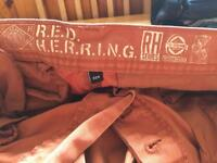 Red herring trousers