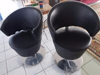 Pair of barber's chairs
