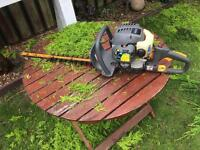 Ryobi two stroke petrol hedge trimmers.