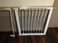 Baby gate with extension panel