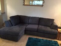 Corner sofa and armchair in grey fabric.