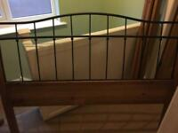 Metal and wooden bed