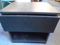 small black bed side cabinet.