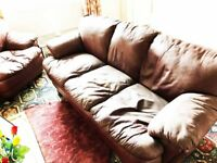 Leather three seater and chair