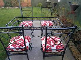 Wrought iron table and chairs.
