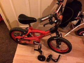 Red Bike for young ones with side wheels