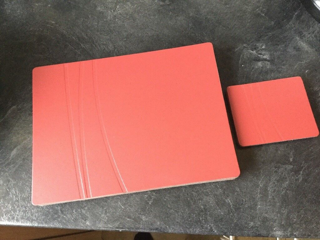 X8 placemats and x4 coasters, red leather