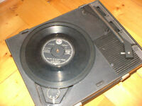 Small portable record player (electric) plays 33/45/78 an early sixties player.