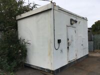Steel contruction portacabin with no windows. Lockable door on front.