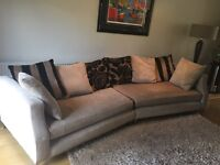 Large sofa with matching swivel armchair