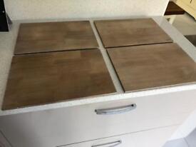 Four Wooden place mats