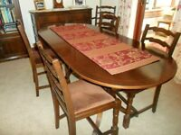 Mahogany veneered dining table and 6 matching chairs