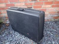 Delsey Black Hard Plastic Suitcase