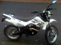 Wk trail 125 cc. 2013 midel mint condition with Mot