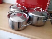 Set of 3 stainless steel copper bottom saucepans with lids