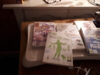 Wii console and fit board 2remote controls five games