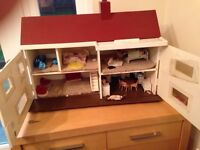 Dolls house with furniture and dolls