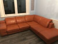 Large Leather Couch....good condition, seats 6.