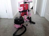 Hetty Hoover and cleaning trolley