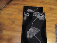 a pair of black /silver velvet curtains