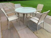 Hartman rattan garden table and chairs and cushions