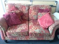 2 seat sofa with cushions