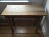 Lovely solid wood table. Makes it great small sewing table. Great upcycle project