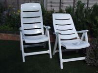 White reclining resin garden chairs