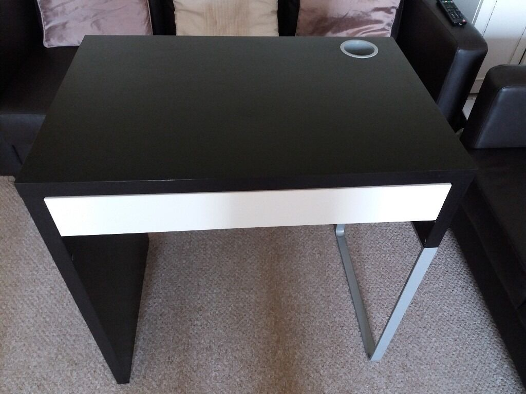 IKEA Micke Desk. Black/brown. Like new. Need gone ASAPin Salford, ManchesterGumtree - IKEA Micke Desk. Hardly used so like new and in very good condition with no issues. In a black/brown colour. Has a white pull out drawer and hole in the top for wires. I need it gone ASAP. Collection only from M6 opposite Salford Shopping City....