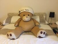 Large teddy bear with bean bag filling