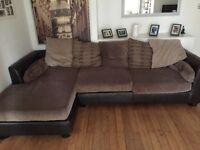 Lovely large corner sofa, leather back, arm rest and base, lovely soft fabric cushions