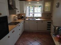Ivory Coloured Kitchen Units with Wooden Door Handles