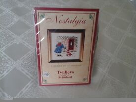 Cross stitch kit of girl posting letter