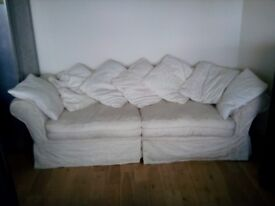 Large 3 to 4 seat sofa and cushions. Courts Brand. Free of charge.
