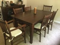 Dark wood dining table and 6 chairs