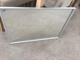 Silver framed wall mirror