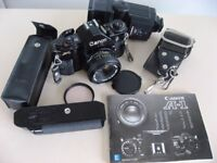 CANON A-1 FILM CAMERA, POWER WINDER, 4 LENSES & FLASH incl INSTRUCTIONS. £225 ONO.