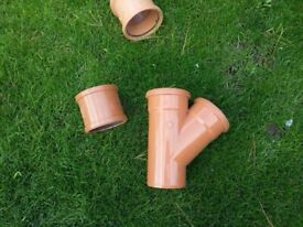 New 110 mm Polypipe soil pipe junction and couplings