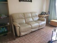 Quality Leather sofa with end electrical recliners.