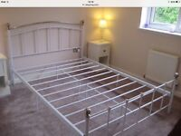 Double bed metal framed. White.