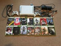 Xbox 360 for sale with a bundle of games and controllers