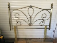 Headboard. Scrolled metal to fit double bed. Good condition.