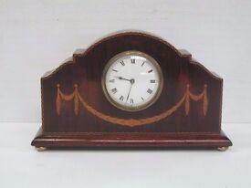 An Edwardian mahogany mantle clock with boxwood swag inlay
