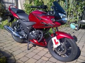 Honda CBF 125 with only 273 miles; immaculate.