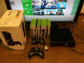 Xbox 360 for sale with 60 games included
