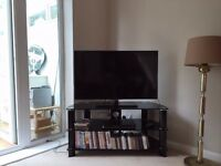 JOHN LEWIS BLACK GLASS TV STAND **EXCELLENT CONDITION**